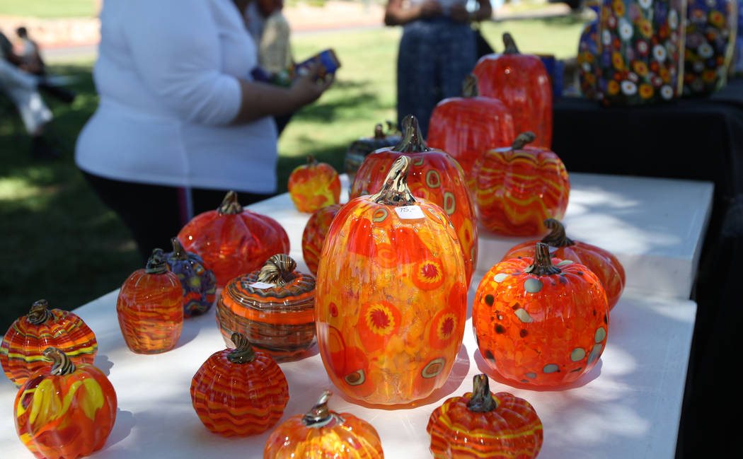 Handblown glass pumpkins from Mad Art Glass on display during the Art in the Park festival in Boulder City, Saturday, Oct. 7, 2017. Gabriella Benavidez Las Vegas Review-Journal @latina_ish