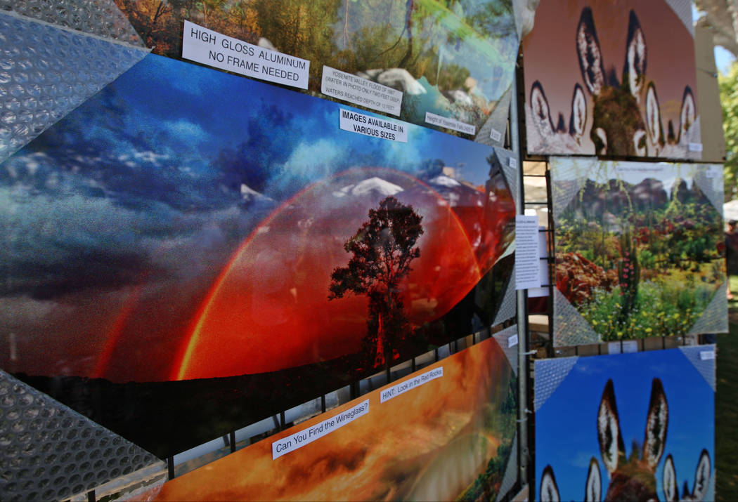 Don Schimmel's photographs printed on high gloss aluminum on display during the Art in the Park festival in Boulder City, Saturday, Oct. 7, 2017. Gabriella Benavidez Las Vegas Review-Journal @lati ...