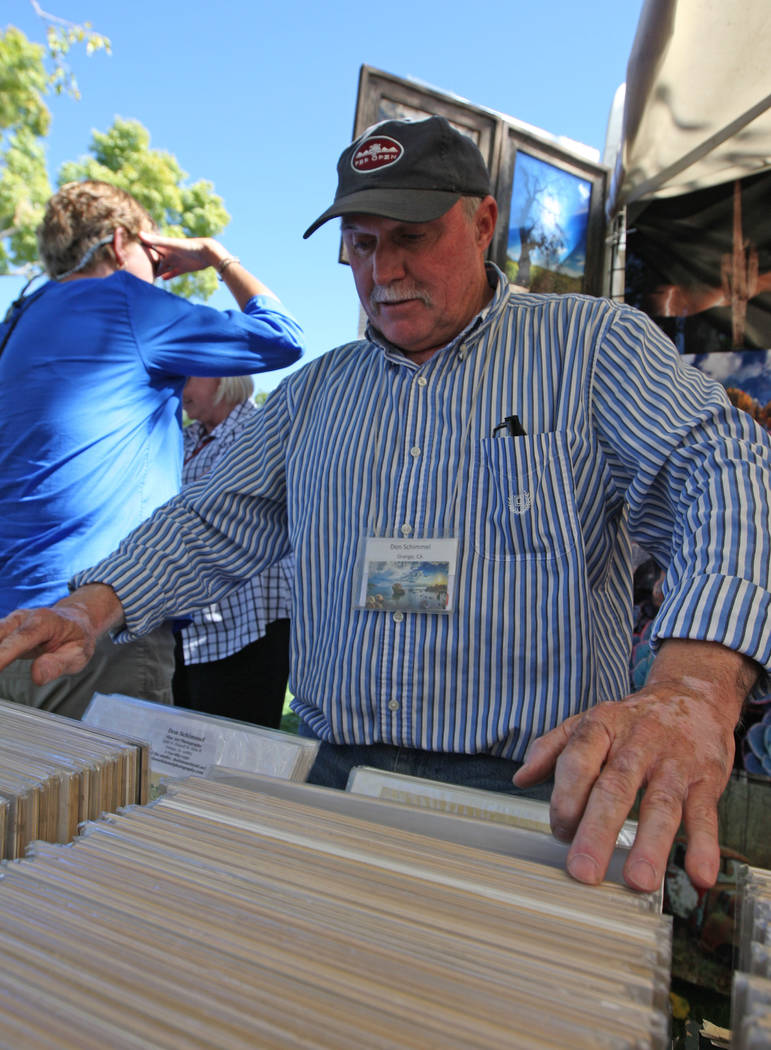 Don Schimmel looks through smaller prints of his photographs for customers during the Art in the Park festival in Boulder City, Saturday, Oct. 7, 2017. Gabriella Benavidez Las Vegas Review-Journal ...