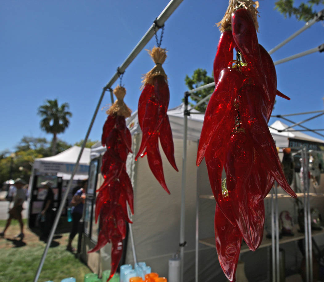 Glass-blown chili peppers from Frus Glass on display during the Art in the Park festival in Boulder City, Saturday, Oct. 7, 2017. Gabriella Benavidez Las Vegas Review-Journal @latina_ish
