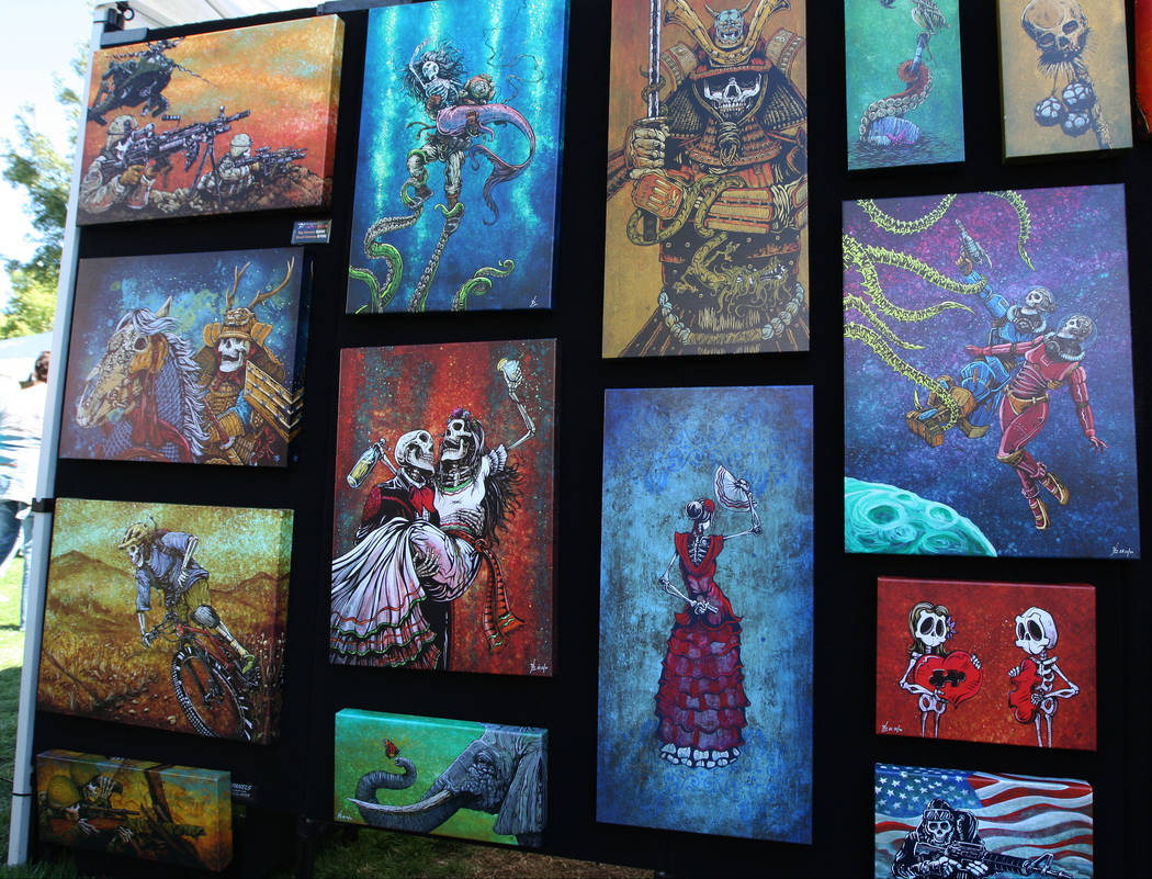 Canvas paintings from The Fyne Art of David Lozeau on display during the Art in the Park festival in Boulder City, Saturday, Oct. 7, 2017. Gabriella Benavidez Las Vegas Review-Journal @latina_ish