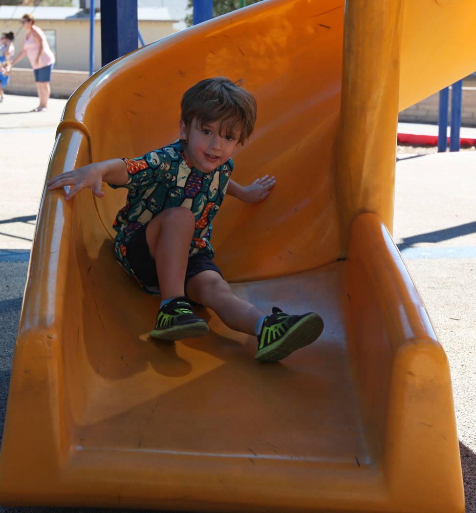 Braydon Celano, 3, enjoys going down the slide during the Art in the Park festival in Boulder City, Saturday, Oct. 7, 2017. Gabriella Benavidez Las Vegas Review-Journal @latina_ish