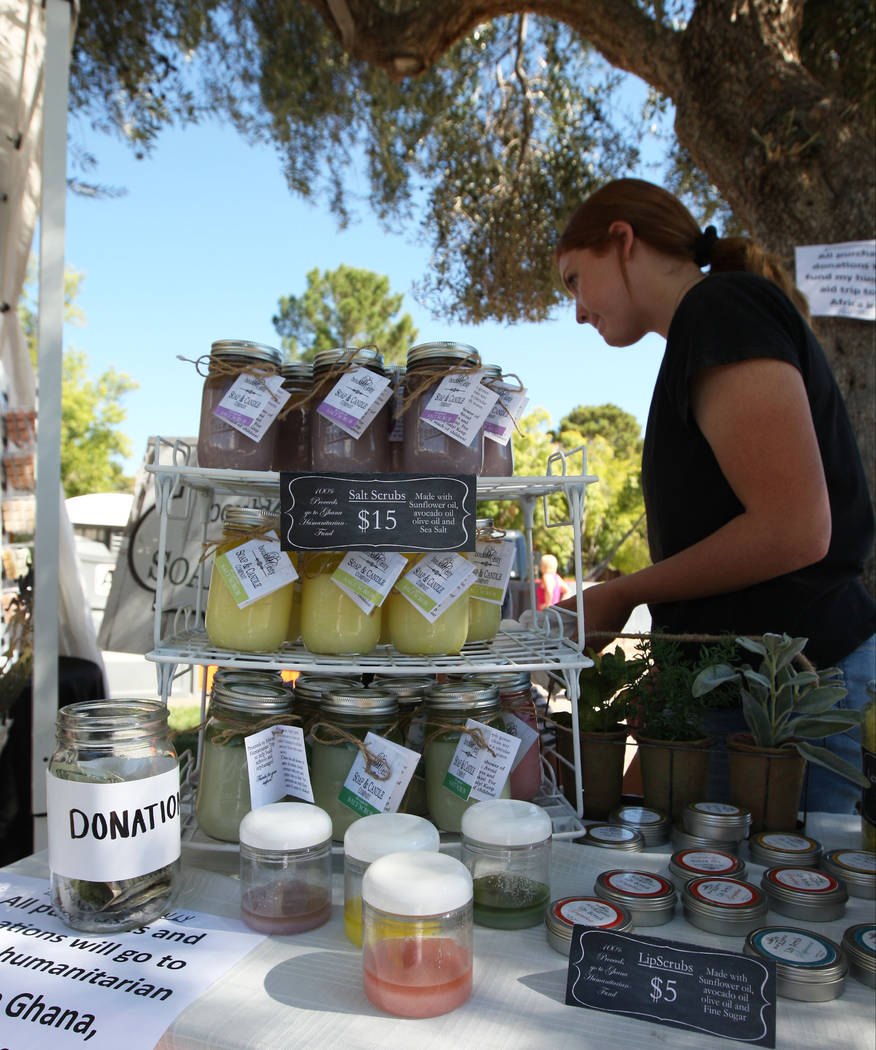 Lizzy Taggard, 16, with Boulder City Soap & Candle Company, bags a purchase for a customer during the Art in the Park festival in Boulder City, Saturday, Oct. 7, 2017. Gabriella Benavidez Las  ...