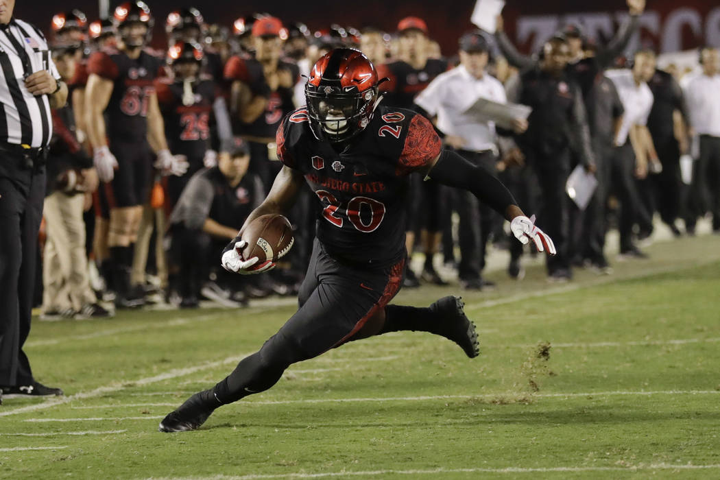 San Diego State running back Rashaad Penny runs during the second half of an NCAA college football game against Northern Illinois Saturday, Sept. 30, 2017, in San Diego. (AP Photo/Gregory Bull)