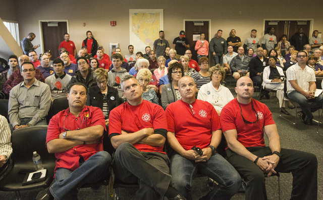 Members of the Professional Firefighters of Nevada union listen during the Assembly Ways and Means Committee telecast hearing on AB190 hearing Wednesday, April 15, 2015, at the Sawyer Building, 55 ...