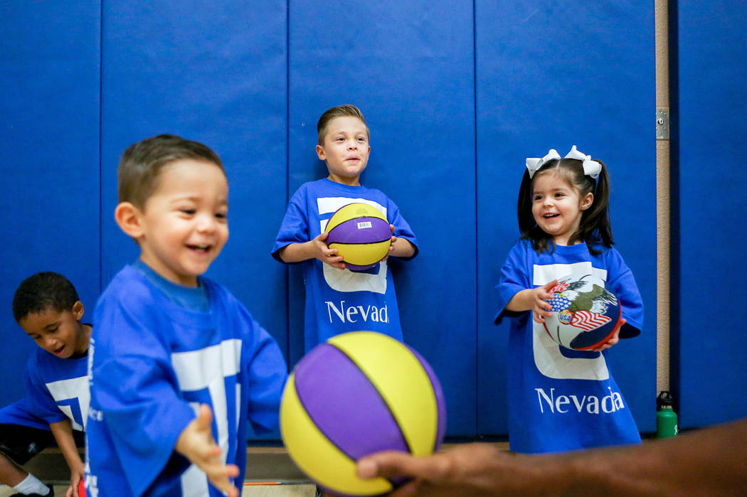 From left, Zion Ellis, 5, Sebastian Sanchez, 3, Mateo Sanchez, 6, Alejandro Sanchez 6, and Carolina Sanchez, 3, practice dribbling during the Center for Autism and Developmental Disabilities Baske ...