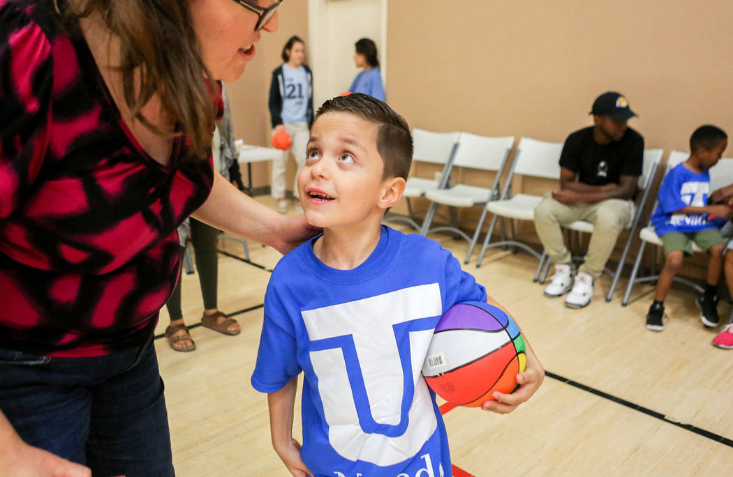 Alejandro Sanchez, 6, center, listens to his mom, Bethany during the Center for Autism and Developmental Disabilities Basketball Clinic at Touro University in Henderson, Sunday, Sept. 10, 2017. El ...