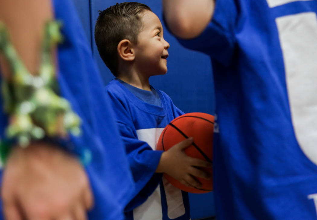 Sebastian Sanchez, 2, learns basket ball drills during the Center for Autism and Developmental Disabilities Basketball Clinic at Touro University in Henderson, Sunday, Sept. 10, 2017. Elizabeth Br ...