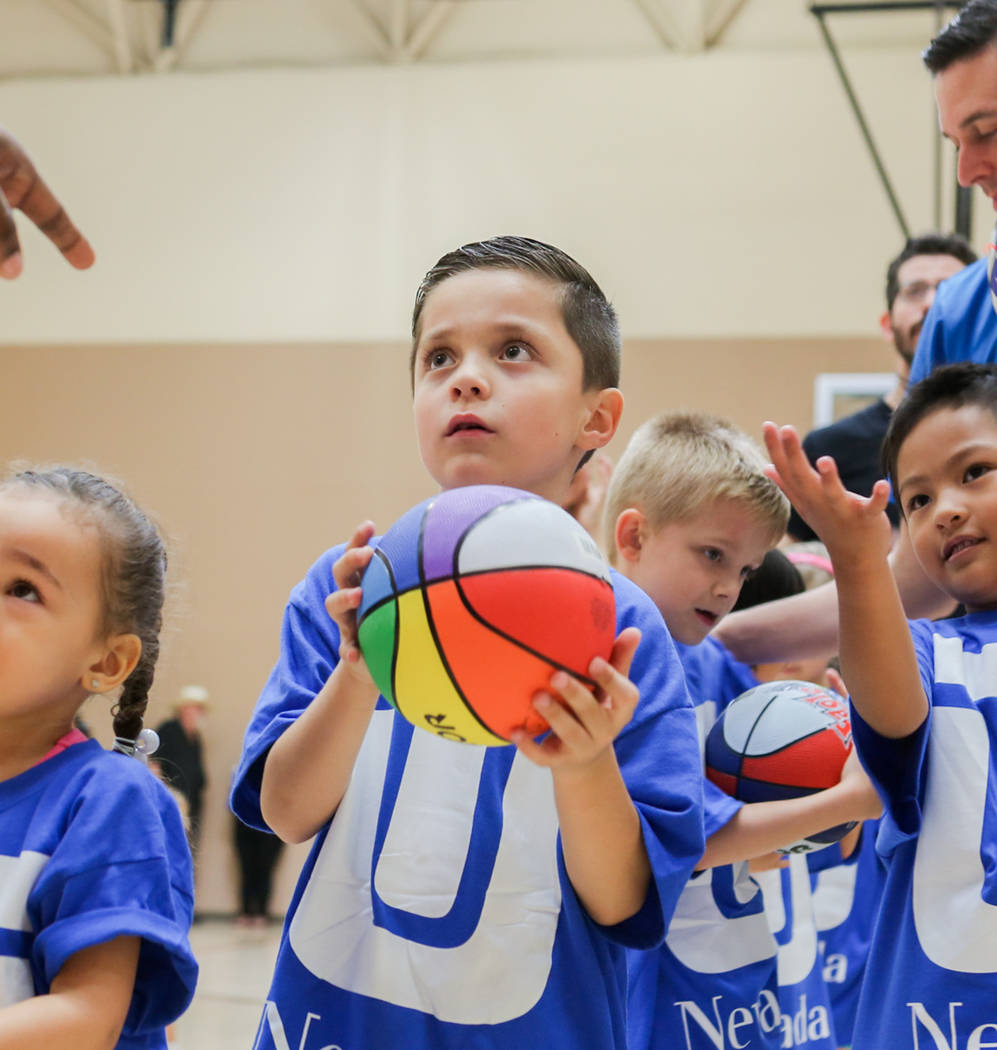 Alejandro Sanchez, 6, center, learns basket ball drills during the Center for Autism and Developmental Disabilities Basketball Clinic at Touro University in Henderson, Sunday, Sept. 10, 2017. Eliz ...