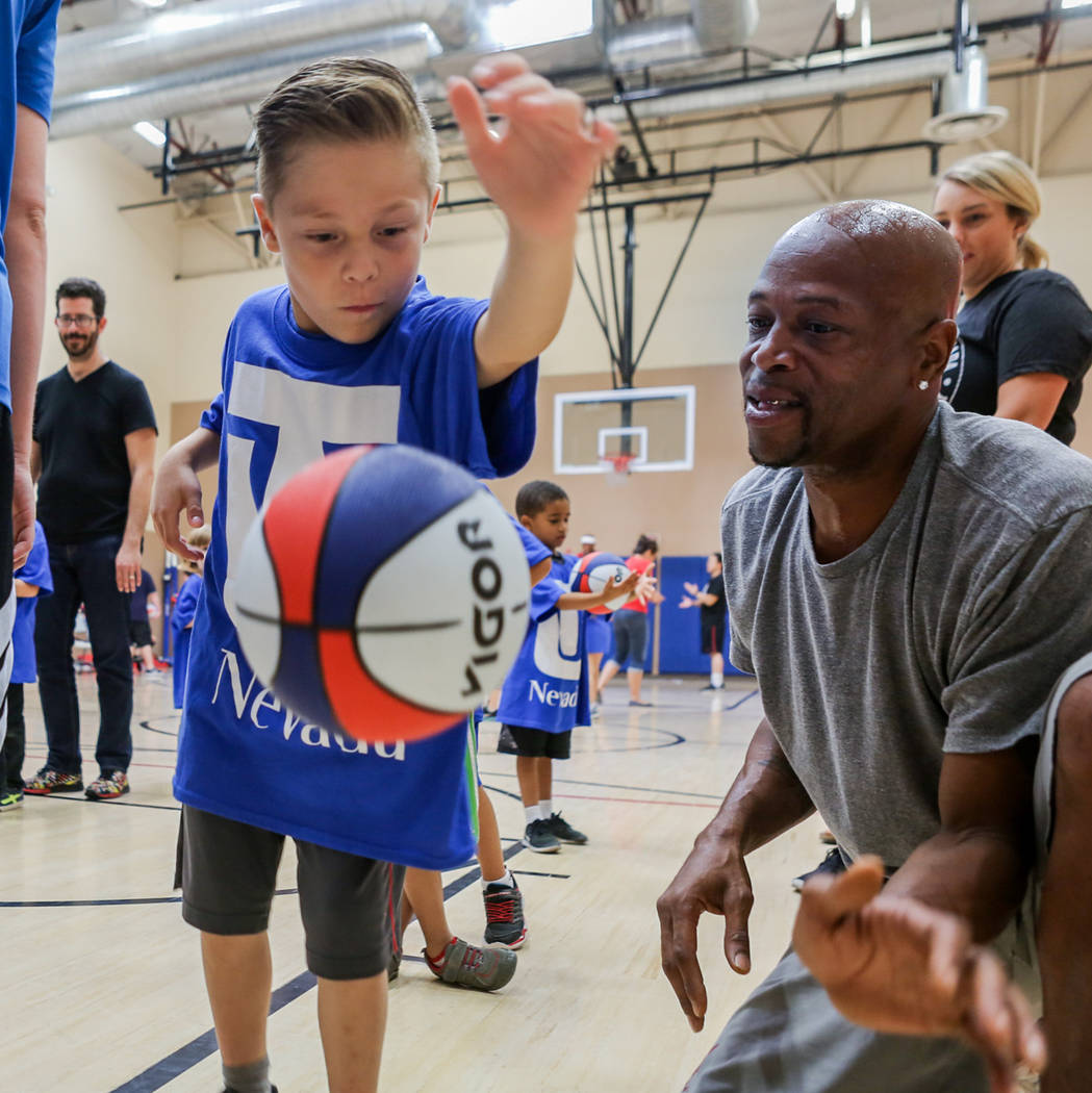 "Mateo Sanchez, 6, left, and James ""Hollywood"" Robinson work on basket ball drills during the Center for Autism and Developmental Disabilities Basketball Clinic at Touro Universit ..."