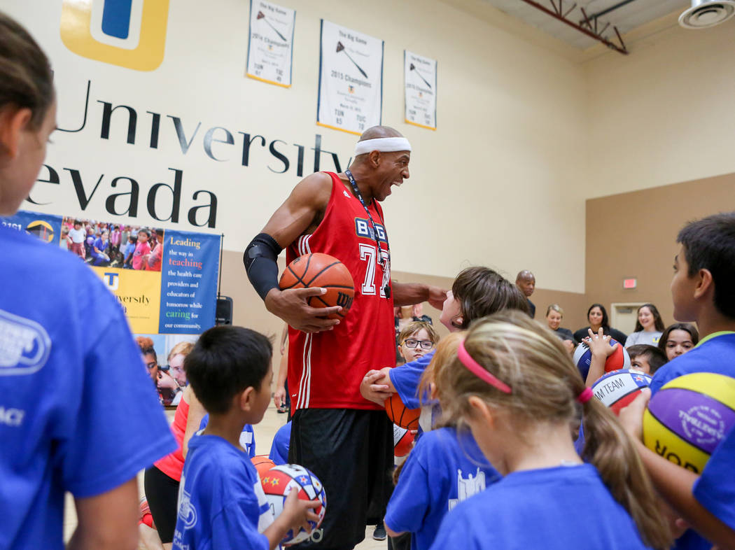 "Former NBA player Jerome ""Junkyard Dog"" Williams, center runs drills for kids participating in the Center for Autism and Developmental Disabilities Basketball Clinic at Touro Uni ..."