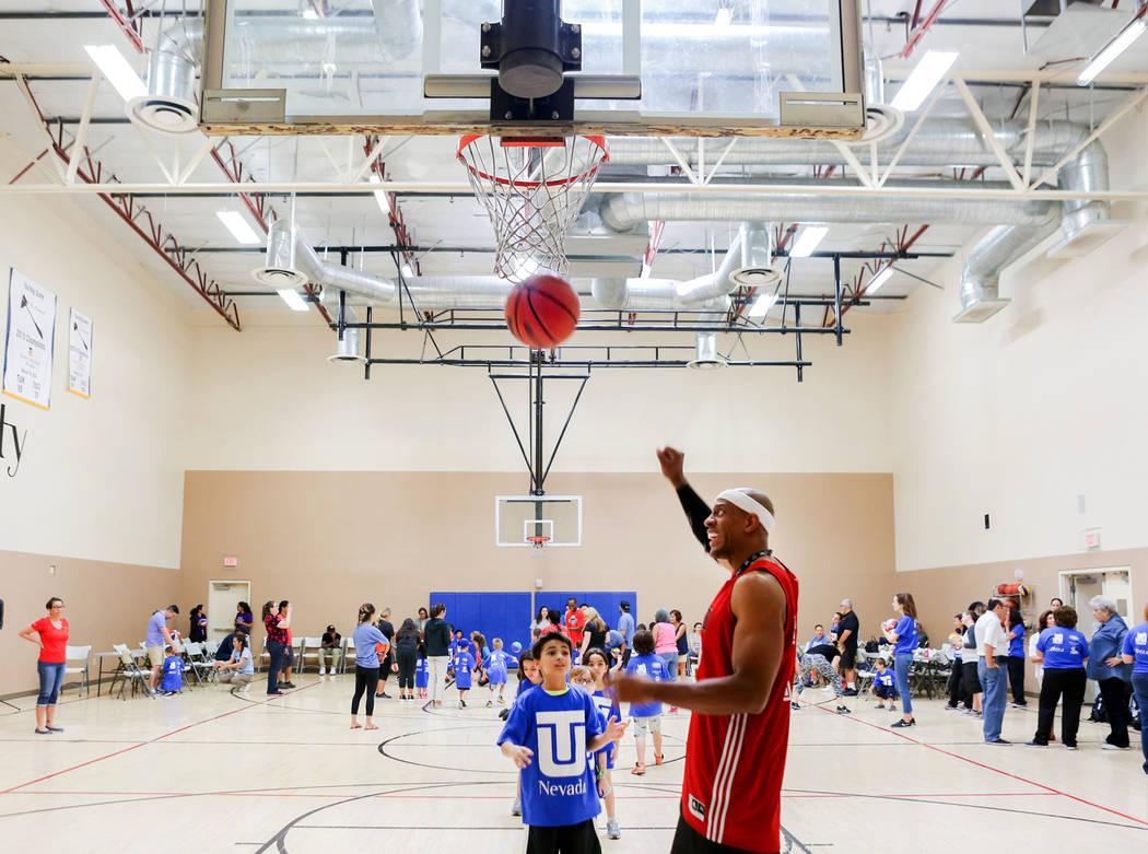 "Former NBA player Jerome ""Junkyard Dog"" Williams, right, runs drills for kids participating in the Center for Autism and Developmental Disabilities Basketball Clinic at Touro Uni ..."