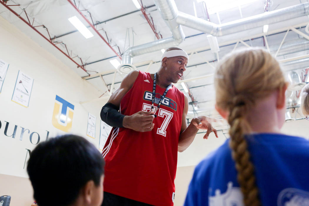 "Former NBA player Jerome ""Junkyard Dog"" Williams leads drills for kids participating in the Center for Autism and Developmental Disabilities Basketball Clinic at Touro University ..."