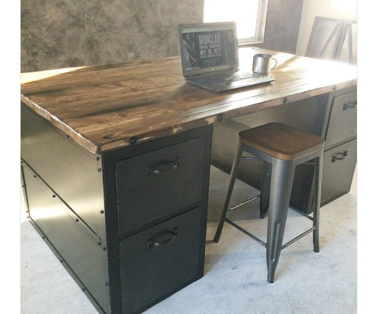 Ironclad Vintage Industrial The Bexley Desk from Ironclad Vintage Industrial has plenty of rivets on its edges, file-sized drawers and an alder wood top.