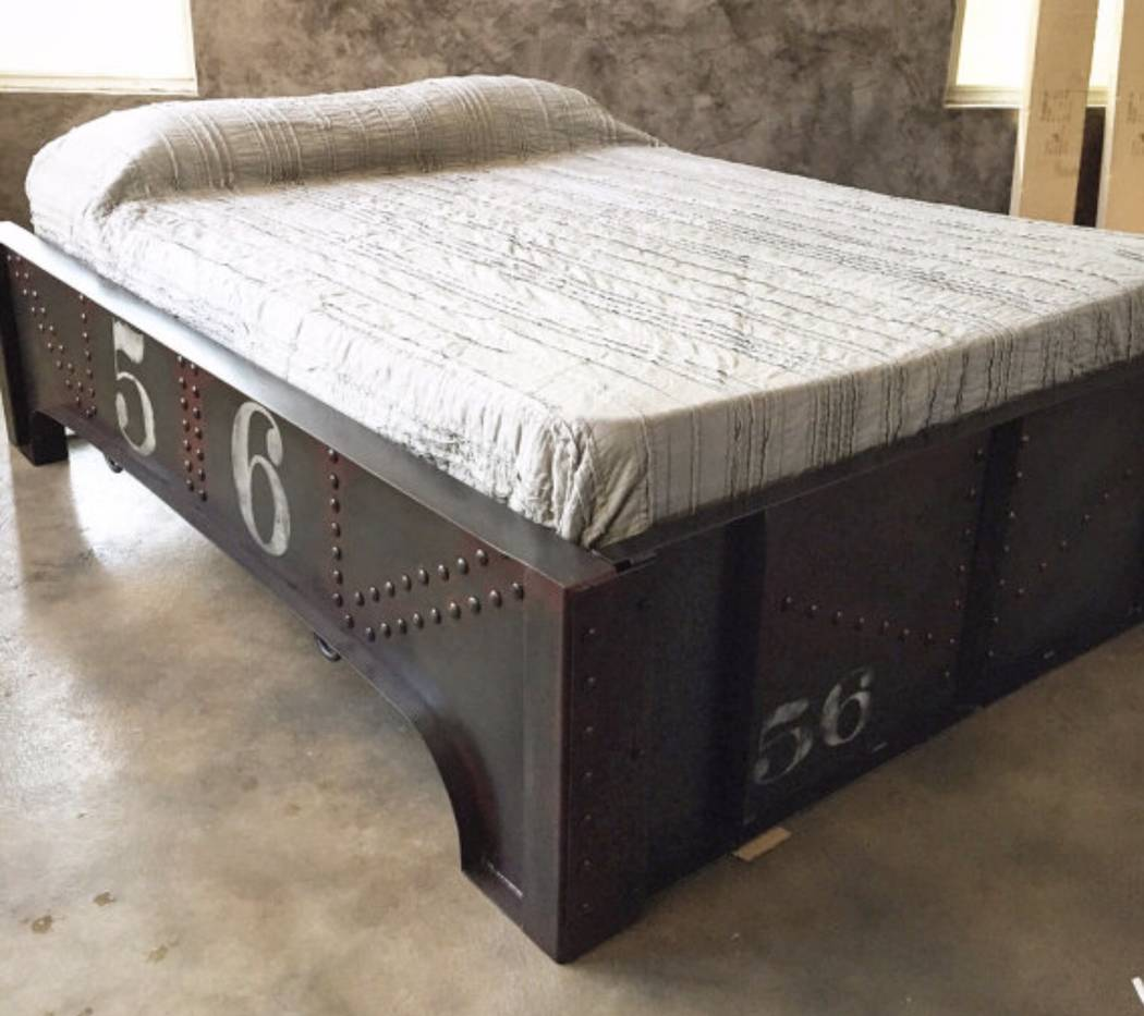 """Ironclad Vintage Industrial The  Danville Bed frame mimics a girder beam you'd find on a train bridge. The piece from Ironclad Vintage Industrial was inspired by the Johnny Cash song """"Wreck of ..."""