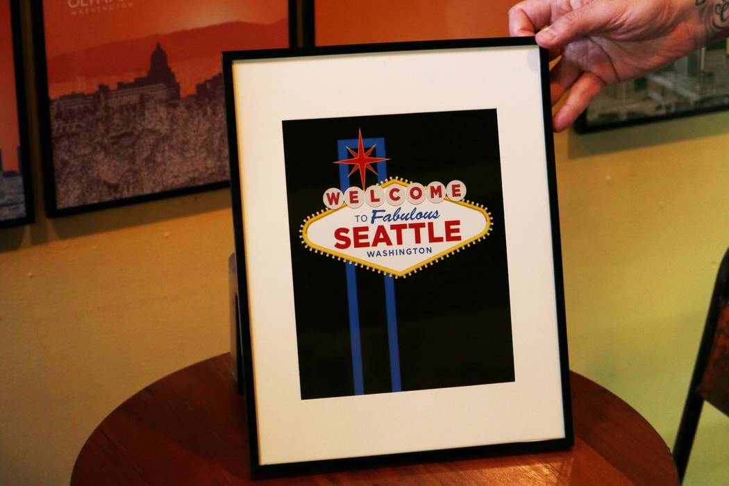 "A ""Welcome to Fabulous Seattle"" sign, modeled after the famed Las Vegas sign, is shown at The Yellow Leaf bakery in Seattle on Tuesday, Sept. 12, 2017. (Eli Segall/Las Vegas Review-Journal)"