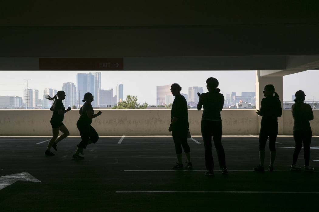 People finish a timed 300 meter run during Las Vegas Metropolitan Police Department's women's boot camp in the parking garage of the Las Vegas Metropolitan Police Department in Las Vegas, Saturday ...