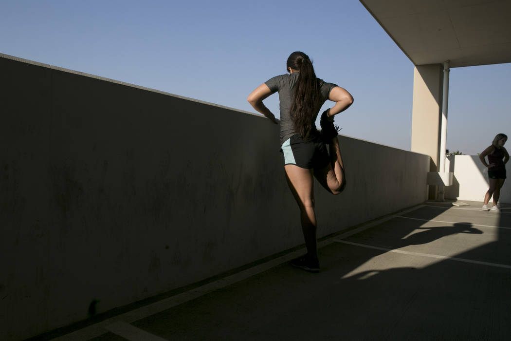 Marlene Garcia, a first-time tester from Las Vegas, stretches after running a timed 300 meter run during Las Vegas Metropolitan Police Department's women's boot camp in the parking garage of the L ...