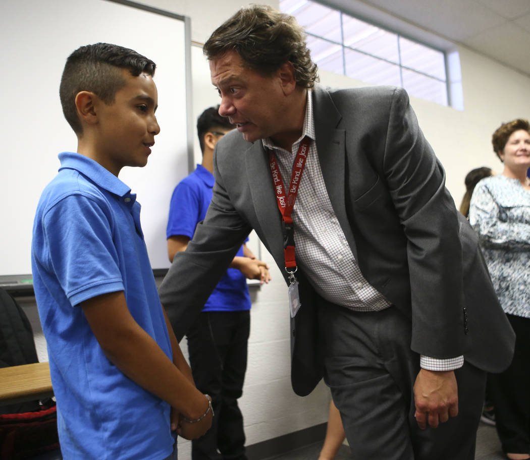 Eighth-grader Miguel Magana, 13, an English language learning student, talks with Clark County School District Superintendent Pat Skorkowsky during the first day of classes at Garside Junior High  ...