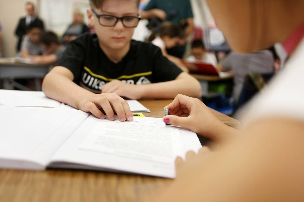 Third-Grade students Brayden Lenahan, 8, left, and Mariana Garcia, 9, work together using investigative science skills using new curriculum, Full Option Science (FOSS), at Pat A. Diskin Elementary ...