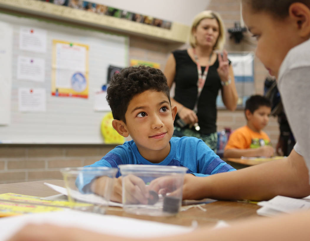 Third-grade students Justin Ugarte, 8, left, and Kaimahni Peters, 8, work together on investigative science skills, a part of the new curriculum Full Option Science (FOSS), at Pat A. Diskin Elemen ...