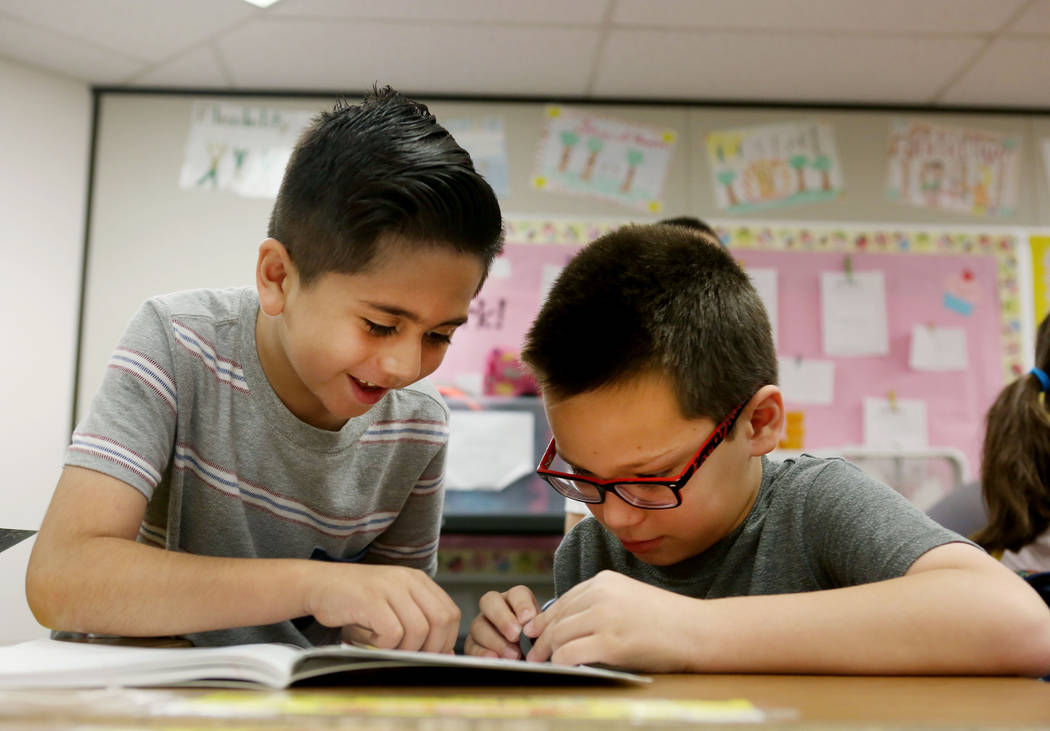 Third-Grade students Abraham Nunez, 8, left, and Jaden Heistond, 8, use investigative science skills using new curriculum, Full Option Science (FOSS), at Pat A. Diskin Elementary in Las Vegas, Thu ...