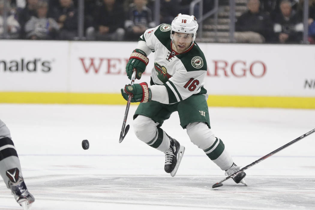Minnesota Wild left wing Jason Zucker shoots during the first period of an NHL hockey game against the Los Angeles Kings in Los Angeles, Saturday, Jan. 7, 2017. (AP Photo/Chris Carlson)