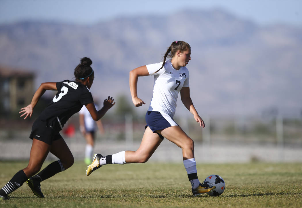 Centennial's Marcella Brooks (7) moves the ball past Palo Verde's Adrianna Serna (3) during a soccer game at Centennial High School in Las Vegas on Tuesday, Sept. 19, 2017. Chase Stevens Las Vegas ...