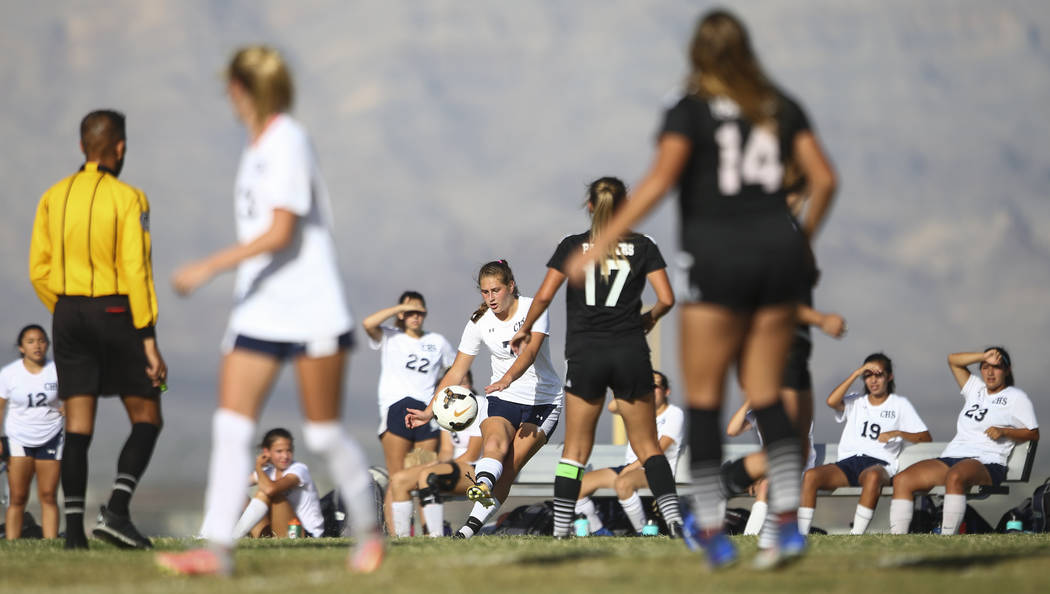 Centennial's Marcella Brooks, center, kicks the ball while playing against Palo Verde in a soccer game at Centennial High School in Las Vegas on Tuesday, Sept. 19, 2017. Chase Stevens Las Vegas Re ...