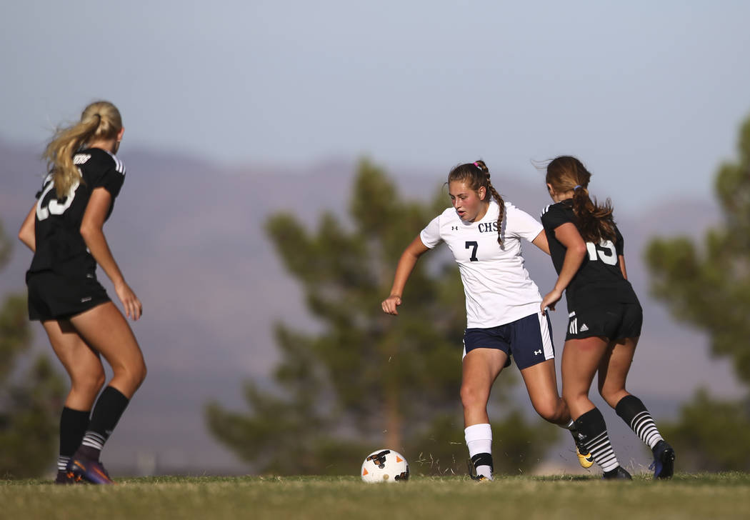 Centennial's Marcella Brooks (7) looks to get around Palo Verde defenders during a soccer game at Centennial High School in Las Vegas on Tuesday, Sept. 19, 2017. Chase Stevens Las Vegas Review-Jou ...