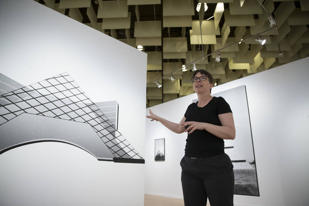 DK Sole, UNLV research and educational engagement specialist, shows artwork by Ian James for the upcoming Preservation exhibition at UNLV's Marjorie Barrick Museum of Art in Las Vegas, Friday, Sep ...