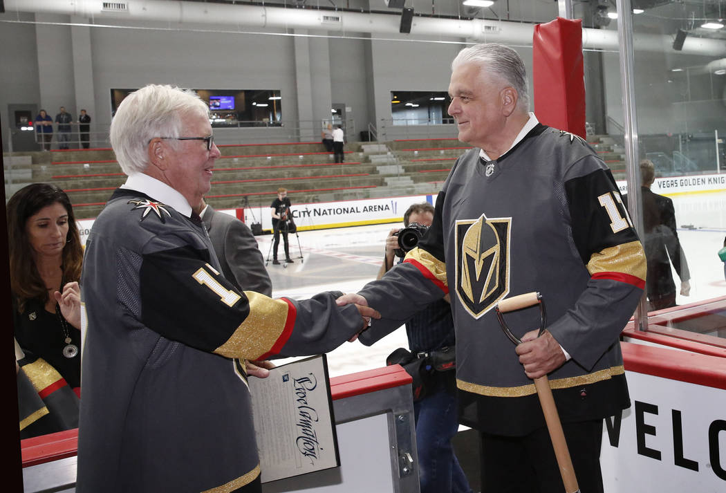 Vegas Golden Knights owner Bill Foley, left, shakes hands with Clark County Commissioner Steve Sisolak after the grand opening ceremony of City National Arena on Monday, Sept. 18, 2017, in Las Veg ...