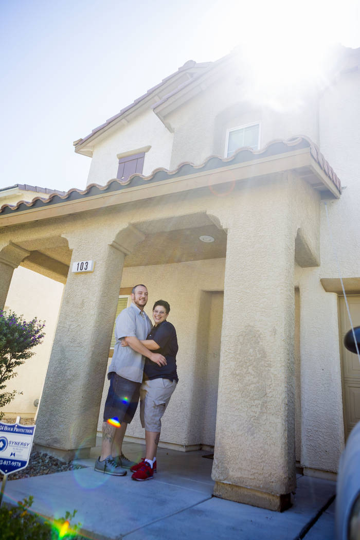 Mike and Sarah DePalo in front of their recently purchased home in Las Vegas, Monday, Sept. 25, 2017. (Elizabeth Brumley/Las Vegas Review-Journal)