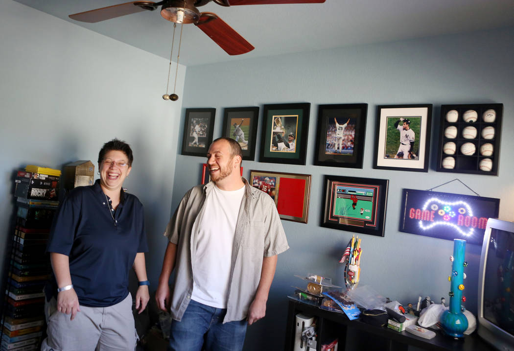 Sarah, left, and Mike DePalo in the game room of their recently purchased home in Las Vegas, Monday, Sept. 25, 2017. (Elizabeth Brumley/Las Vegas Review-Journal)
