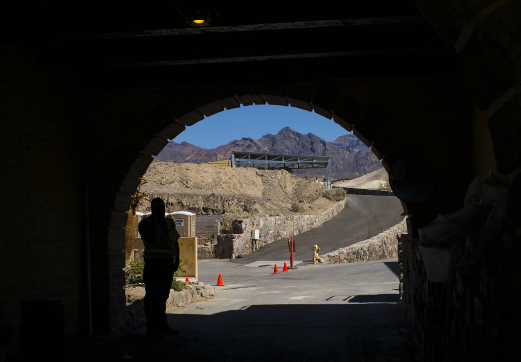 A construction worker is silhouetted at the Inn at Death Valley on Thursday, Sept. 28, 2017. Originally called the Furnace Creek Ranch, the newly renamed resort area at the famed national park is  ...