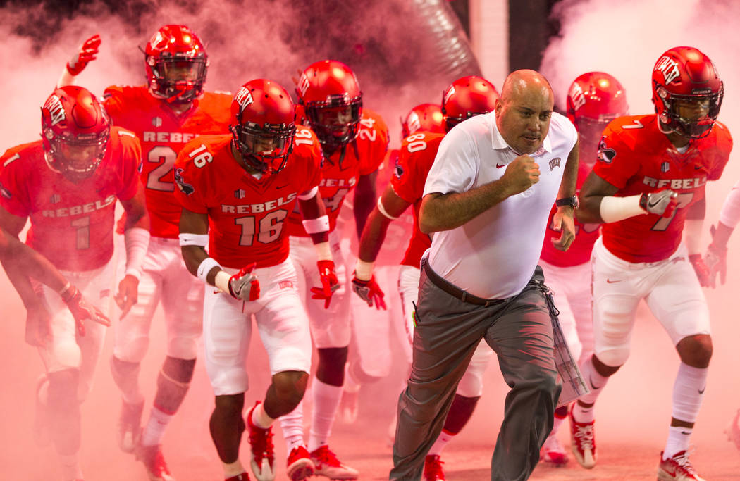 UNLV Rebels head coach Tony Sanchez and his players hit the field before the start of an NCAA college football game between the UNLV Rebels and the San Jose State Spartans at Sam Boyd Stadium on S ...