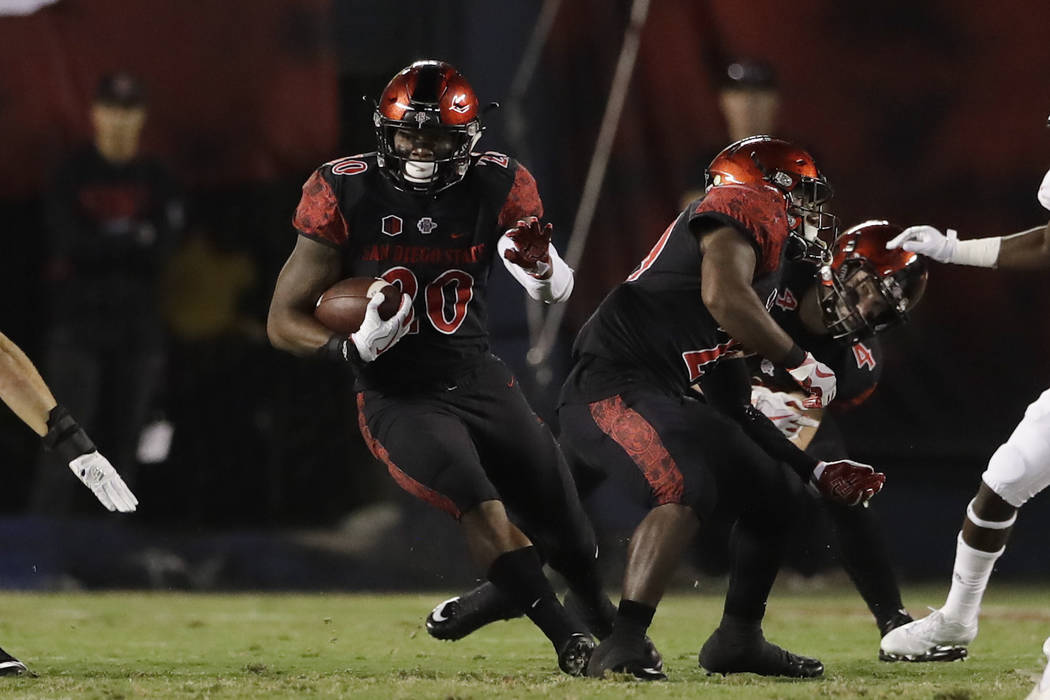 San Diego State running back Rashaad Penny runs with the ball during the first half of an NCAA college football game against Northern Illinois, Saturday, Sept. 30, 2017, in San Diego. (AP Photo/Gr ...