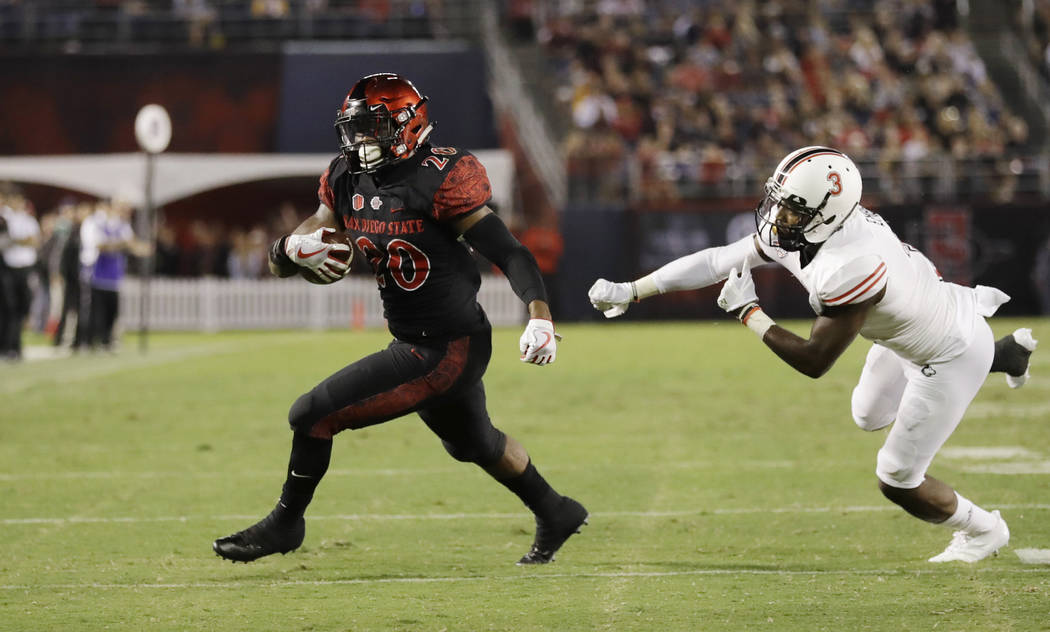 San Diego State running back Rashaad Penny runs past Northern Illinois cornerback Jalen Embry during the second half of an NCAA college football game Saturday, Sept. 30, 2017, in San Diego. (AP Ph ...