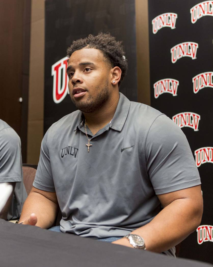 UNLV defensive lineman Mike Hughes Jr. does an interview with multiple different print medias during the Mountain West football Media Summit at the Cosmopolitan hotel-casino in Las Vegas, July 25, ...