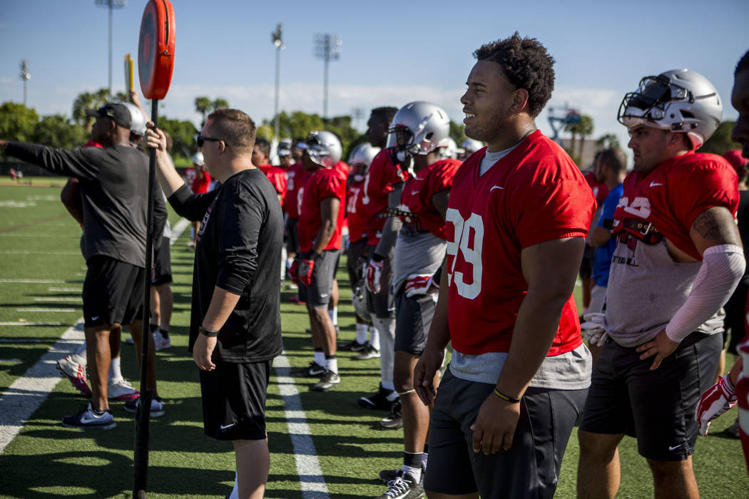UNLV defensive tackle Mike Hughes Jr. watches his teammates run a scrimmage during training camp at Rebel Park on Tuesday, Aug. 8, 2017.  Patrick Connolly Las Vegas Review-Journal @PConnPie