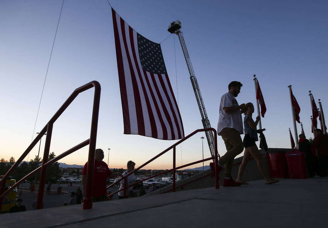 Clark County Fire Department and Las Vegas Fire & Rescue join together to raise up the American flag before a football game between UNLV and San Diego State at Sam Boyd Stadium in Las Vegas on ...