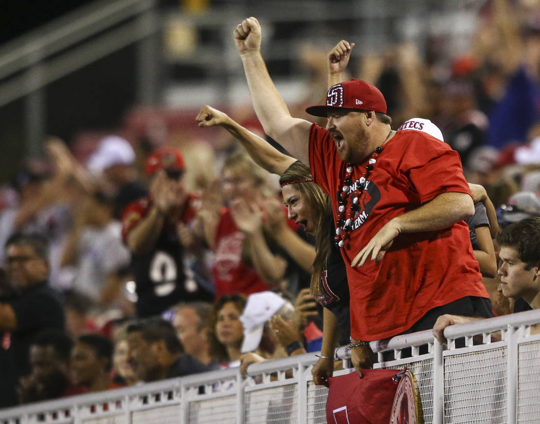San Diego State fans cheer after a touchdown by San Diego State's Christian Chapman during a football game against UNLV at Sam Boyd Stadium in Las Vegas on Saturday, Oct. 7, 2017. Chase Stevens La ...