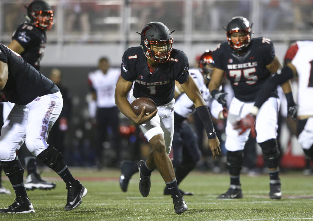 UNLV's Armani Rogers (1) runs the ball against San Diego State during a football game at Sam Boyd Stadium in Las Vegas on Saturday, Oct. 7, 2017. Chase Stevens Las Vegas Review-Journal @csstevensphoto