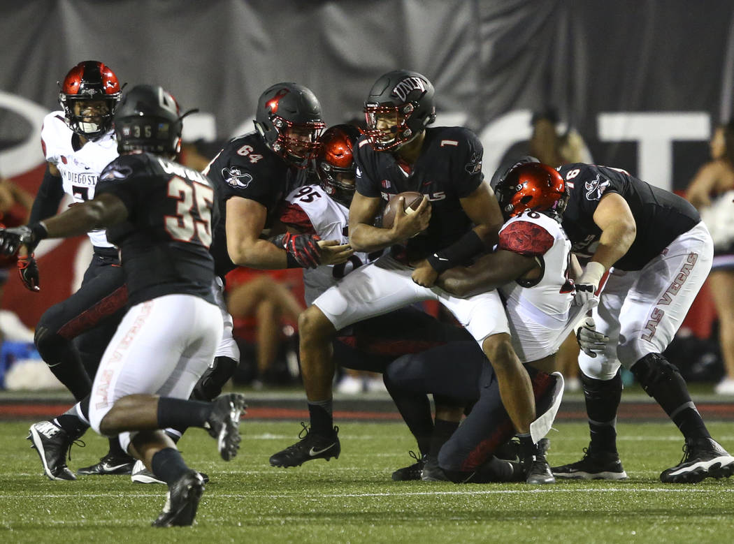 UNLV's Armani Rogers (1) is sacked by San Diego State defenders during a football game at Sam Boyd Stadium in Las Vegas on Saturday, Oct. 7, 2017. Chase Stevens Las Vegas Review-Journal @csstevens ...