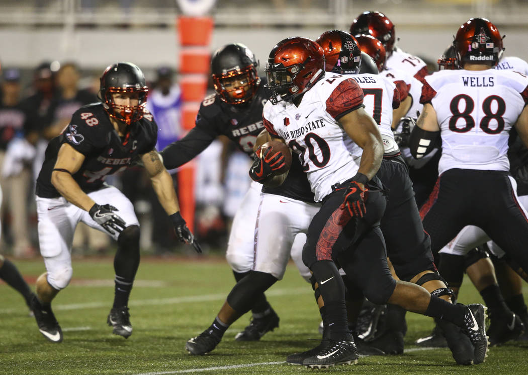 San Diego State's Rashaad Penny (20) runs the ball against UNLV during a football game at Sam Boyd Stadium in Las Vegas on Saturday, Oct. 7, 2017. Chase Stevens Las Vegas Review-Journal @csstevens ...