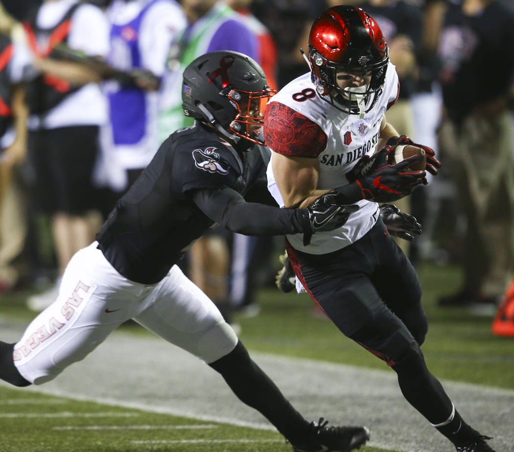 UNLV's Jericho Flowers (7) reaches out to tackle San Diego State's Quest Truxton (8) during a football game at Sam Boyd Stadium in Las Vegas on Saturday, Oct. 7, 2017. Chase Stevens Las Vegas Revi ...