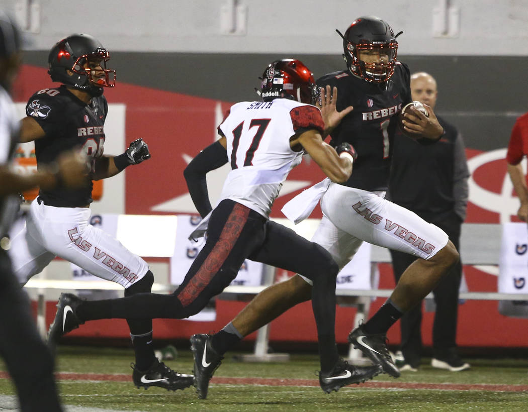 UNLV's Armani Rogers (1) runs the ball past San Diego State's Ron Smith (17) during a football game at Sam Boyd Stadium in Las Vegas on Saturday, Oct. 7, 2017. Chase Stevens Las Vegas Review-Journ ...
