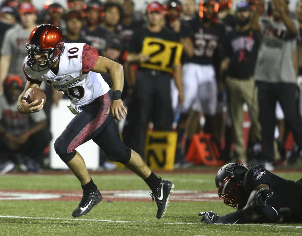 San Diego State's Christian Chapman (10) runs the ball past a UNLV defender during a football game at Sam Boyd Stadium in Las Vegas on Saturday, Oct. 7, 2017. Chase Stevens Las Vegas Review-Journa ...
