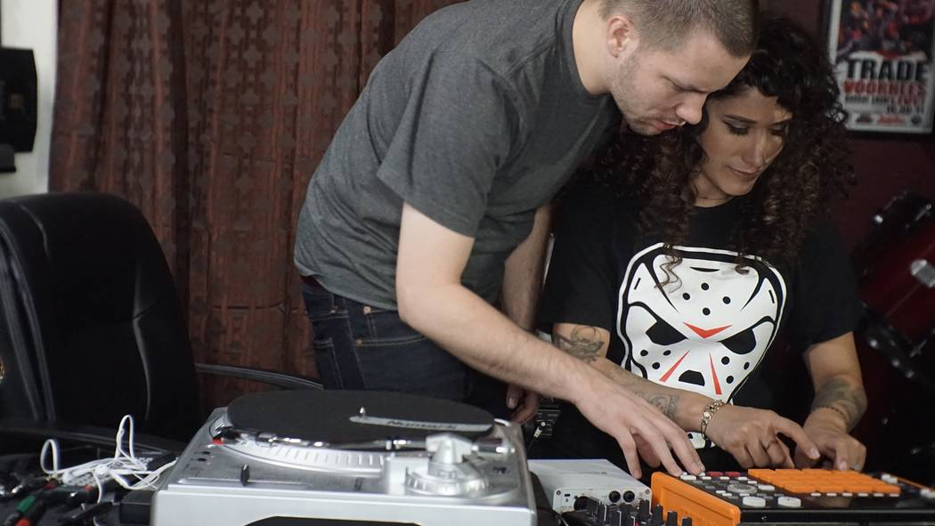 Stephan Perren assists his wife Amy on a MPC 1000 beat making machine in their home studio. (Courtesy of Stephan Perren)