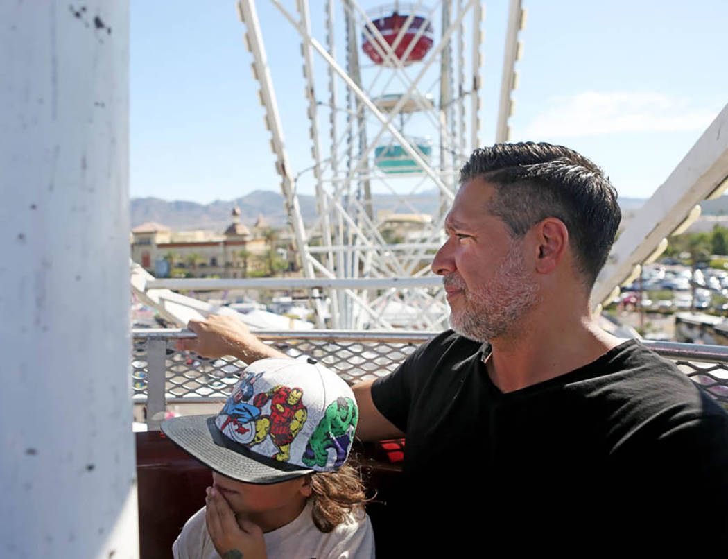 Kalex Scott, 6, and Michael Scott ride the Ferris wheel at the Great American Foodie Fest at the Sunset Station in Henderson, Sunday, Oct.1, 2017. Elizabeth Brumely Las Vegas Review-Journal
